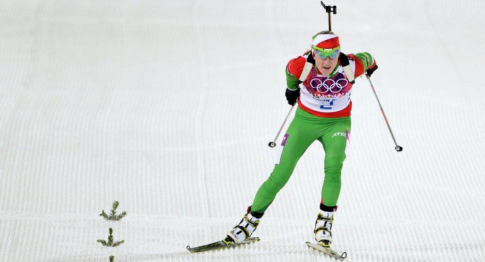 Дарья Домрачева на финише гонки с масс-старта на зимних Олимпийских играх в Сочи