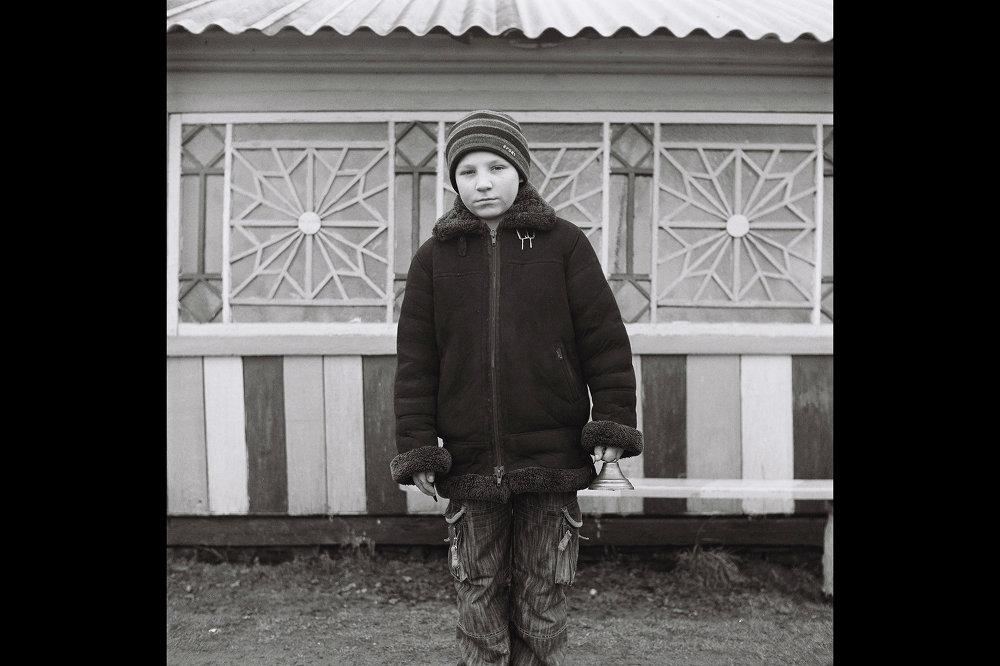 Хлопчык з бубенчыкам падчас святкавання Каляд