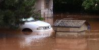 СПУТНИК_Затопленные дома и дороги – последствия наводнения в США после мощных ливней