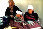 Сирийцы, пострадавшие в результате боевых действий