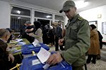 Иранцы голосуют на выборах в парламент