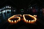 Символ Часа Земли, составленный из свечей