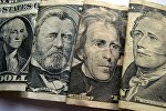 Портреты мужчин на американских долларах