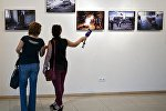 Фотовыставка в поддержку фотокорреспондента МИА Россия Сегодня Андрея Стенина