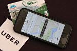 Приложение Uber на смартфоне и карточка Белкарт