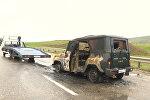 СПУТНИК_Искореженные автомобили на месте подрыва автоколонны МВД в Дагестане