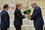 Франсуа Олланд, Ангела Меркель и Александр Лукашенко во Дворце Независимости