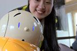 Спутник_Робот-монах читал мантры и развлекал прихожан буддистского храма в Пекине