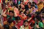 Индийские индуистские женщины во время фестиваля Гангаур