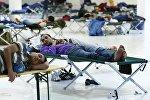 Мігранты ў лагеры для ўцекачоў у Германіі