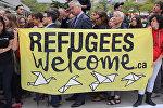 СПУТНИК_Добро пожаловать, беженцы – сотни канадцев митинговали в защиту мигрантов
