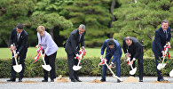 (L to R) Italian Prime Minister Matteo Renzi, German Chancellor Angela Merkel, US President Barack Obama, Japan's Prime Minister Shinzo Abe, French President Francois Hollande, Britain's Prime Minister David Cameron, Canadian Prime Minister Justin Trudeau and European Commission President Jean-Claude Juncker take part in a tree planting ceremony on the grounds at Ise-Jingu Shrine in the city of Ise in Mie prefecture, on May 26, 2016 on the first day of the G7 leaders summit