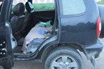 Машина, из которой выпал ребенок