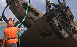 СПУТНИК_Найденный штурмовик Ил-2 времен ВОВ краном подняли со дна Черного моря