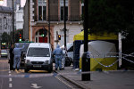 Police forensic officers work in Russell Square in London early on August 4, 2016, after a woman in her 60s was killed during a knife attack
