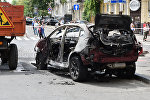 Взорванный автомобиль на перекрестке улиц Богдана Хмельницкого и Ивана Франко, в котором погиб журналист Павел Шеремет
