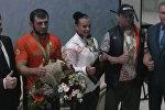 Верым, можам: белорусы встретили медалистов олимпиады в аэропорту