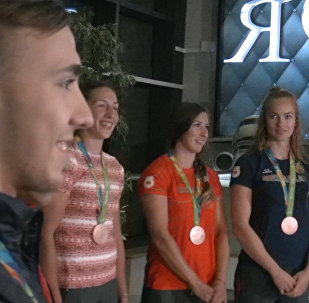 Олимпийцев встретили в аэропорту