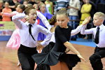 Выступление юных спортсменов на турнире по спортивным бальным танцам