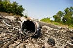 Снаряд на территории территорию Донецкой фильтровальной станции на линии соприкосновения в Донбассе между городами Ясиноватая и Авдеевка