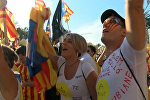 СПУТНИК_Тысячи барселонцев пели и танцевали на акции за независимость Каталонии