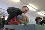 СПУТНИК_Выборы в Госдуму РФ: как избиратели голосовали в России и за рубежом
