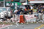 Представители ФБР собирают доказательства на месте взрыва в Нью-Йорке