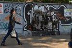 Вандалы повредили граффити на Октябрьской