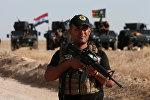 Боец курдского ополчения  на подступах к Мосулу
