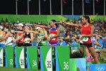 Спортсменки в соревнованиях по бегу и стрельбе (комбайну) среди женщин в современном пятиборье