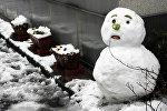 Снеговик во время оттепели