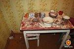 Кухня в квартире, где был найден убитый житель Городка