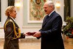 Президент Александр Лукашенко вручил орден За службу Родине заместителю начальника НИИ пожарной безопасности и проблем чрезвычайных ситуаций МЧС Елене Дмитрук