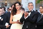 Американский актер Джордж Клуни и его жена британский адвокат Амаль Клуни