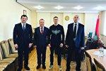 Виталий Гурков (второй справа)