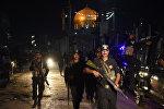 Полицейские Пакистана после теракта в городе Сехван-Шариф