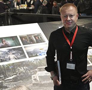 Фотокорреспондент Sputnik Валерий Мельников на открытии выставки победителей World Press Photo в Амстердаме