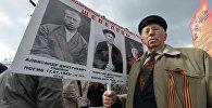 Участник акции Бессмертный полк в Минске