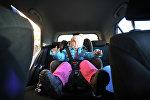 Детское автомобильное кресло, архивное фото