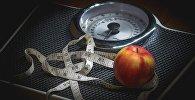 Шалі, сантыметр і яблык, архіўнае фота