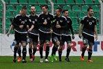 Игроки сборной Белоруссии радуются забитому голу во время товарищеского матча между сборными командами Беларуси и Новой Зеландии