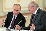 Президенты РФ и Беларуси В. Путин и А. Лукашенко на заседании ВГС Союзного государства