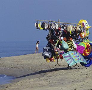 Продавец пляжных товаров