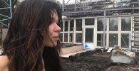Руслана возле своего дома,в который попала молния