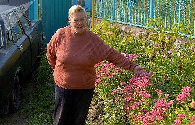 Соседка Грабовского призналась, что стена ей никак не мешает, и похвасталась своими цветами