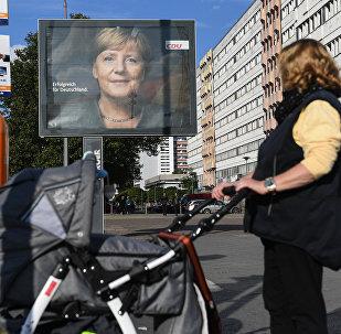 Плакат с изображением канцлера Германии, лидера Христианско-демократического союза Ангелы Меркель