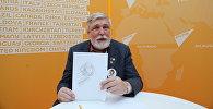 Известный художник и автор символа Всемирного фестиваля молодежи и студентов 1985 года Михаил Веременко