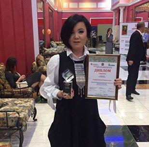 Корреспондент Sputnik Казахстан Асем Миржекеева на вручении награды на конкурсе Диво Евразии, фото с места событий