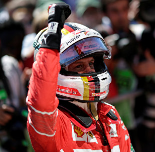 Победитель Гран-при Бразилии Себастьян Феттель
